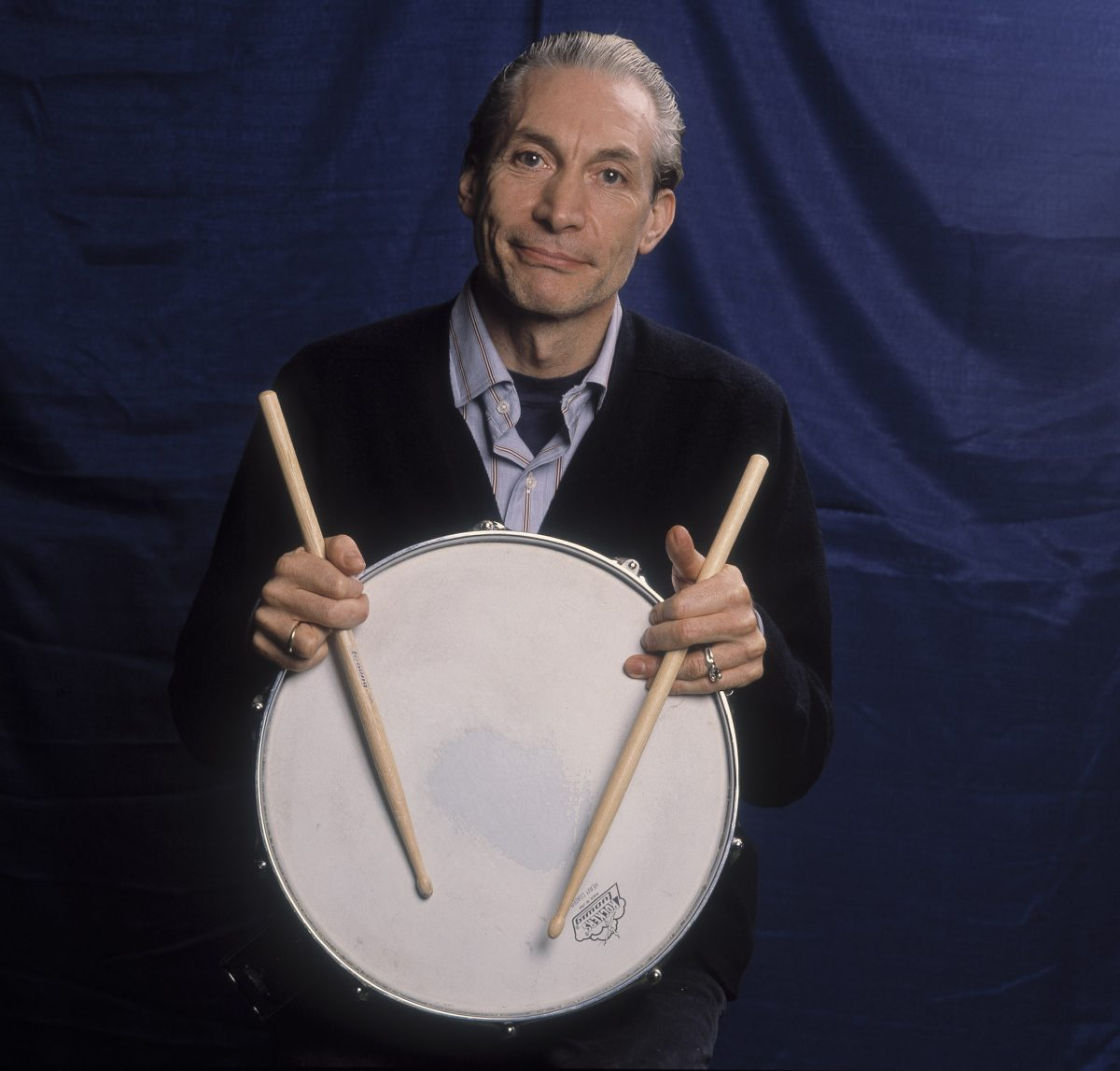 The Rolling Stones' Charlie Watts with a drum