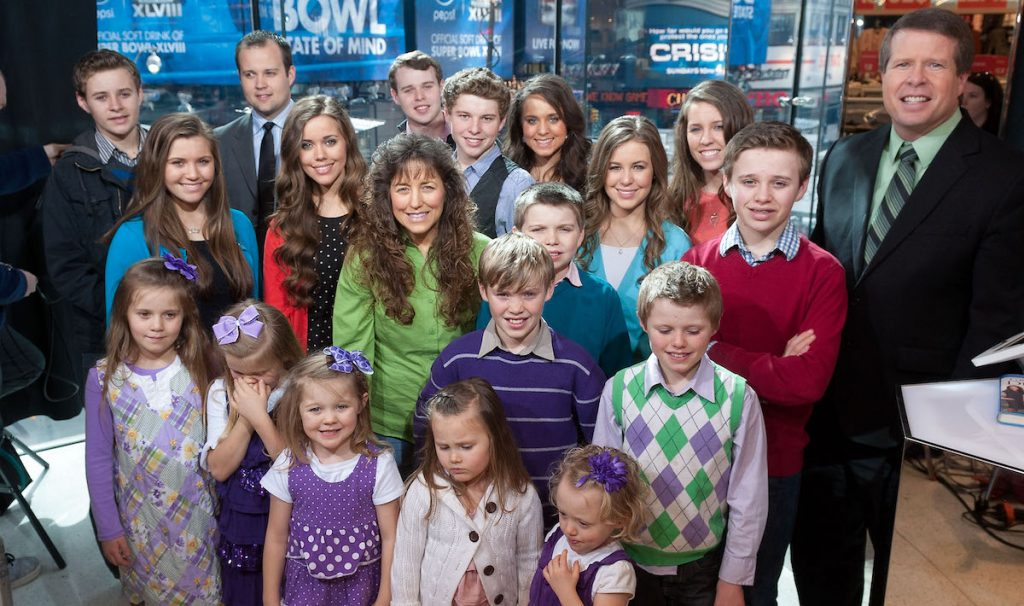 """Jim Bob and Michelle Duggar, who now have a growing number of grandchildren, visits """"Extra"""" at their New York studios with their 19 kids."""