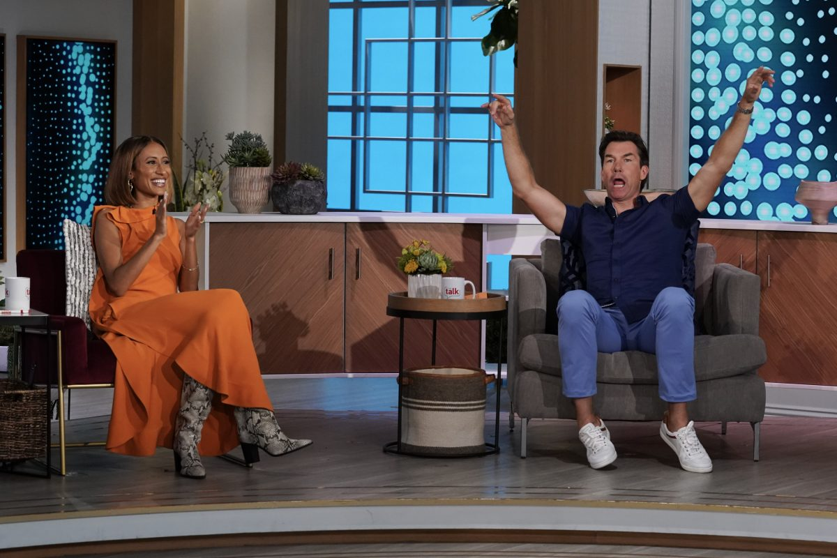 Elaine Welteroth claps while Jerry O'Connell cheers on the set of 'The Talk'