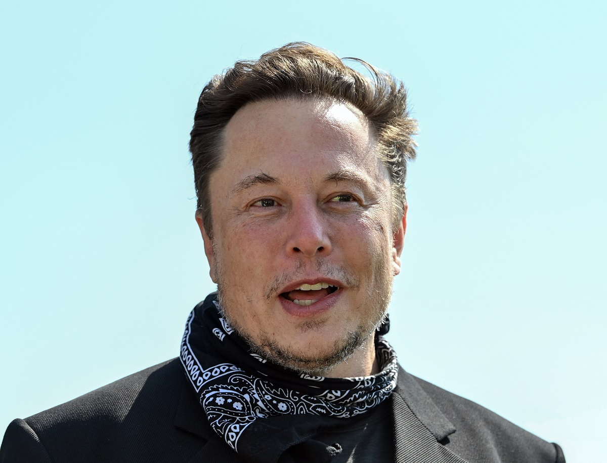 Elon Musk, Tesla CEO, stands at a press event on the grounds of the Tesla Gigafactory.