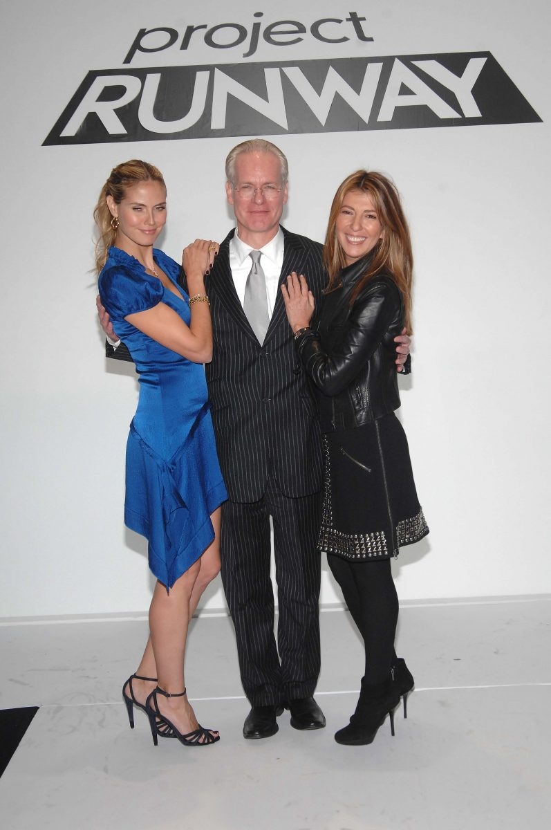 Tim Gunn in the middle being hugged by Heidi Klum on the left and Nina Garcia on the right on the 'Project Runway' runway