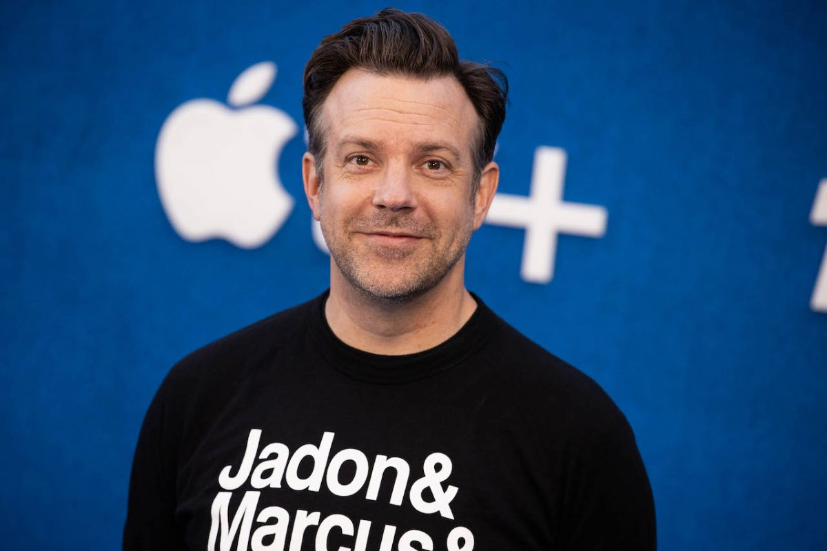 Jason Sudeikis pictured from the chest up in a black shirt at Apple's 'Ted Lasso' season 2 premiere