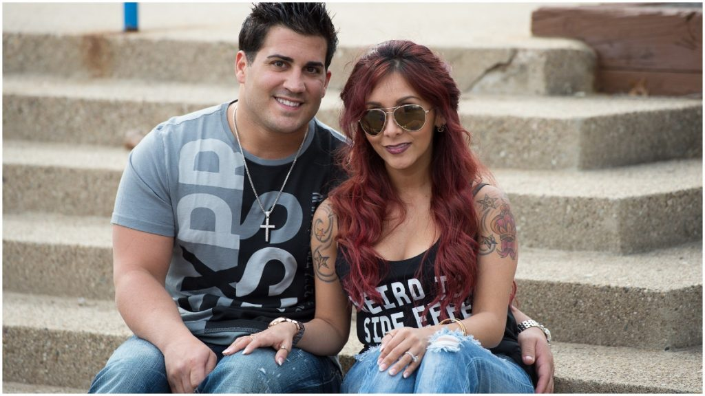 Nicole Polizzi and Jionni LaValle sit together for a posed photograph.