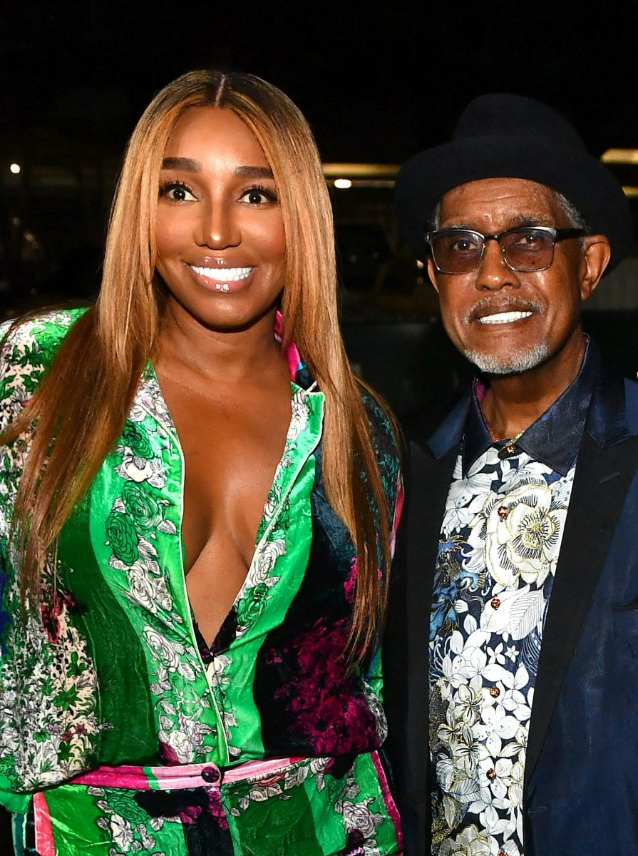 Nene Leakes and her husband Gregg smiling during the opening of The Linnethia Lounge