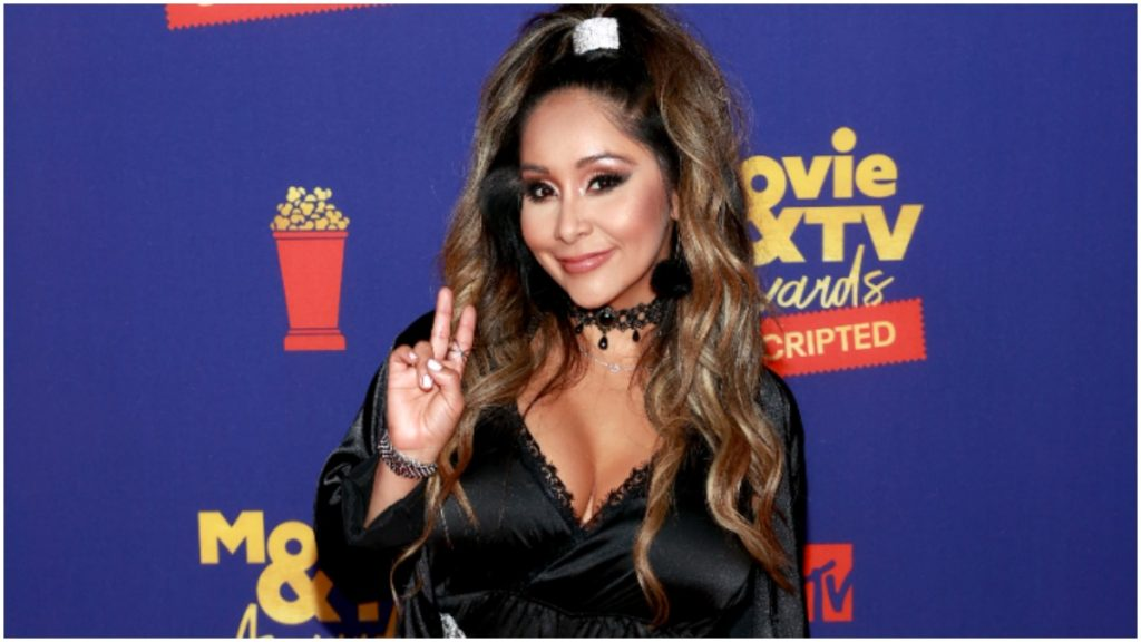 Nicole Polizzi poses on the red carpet for a photo.