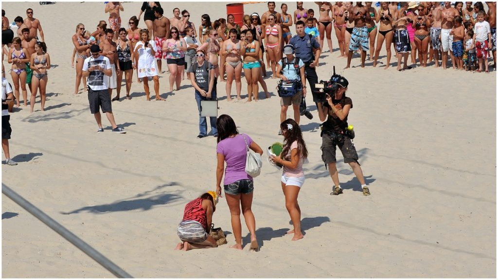 Nicole Polizzi is drunk on the beach in a Jersey Shore episode.