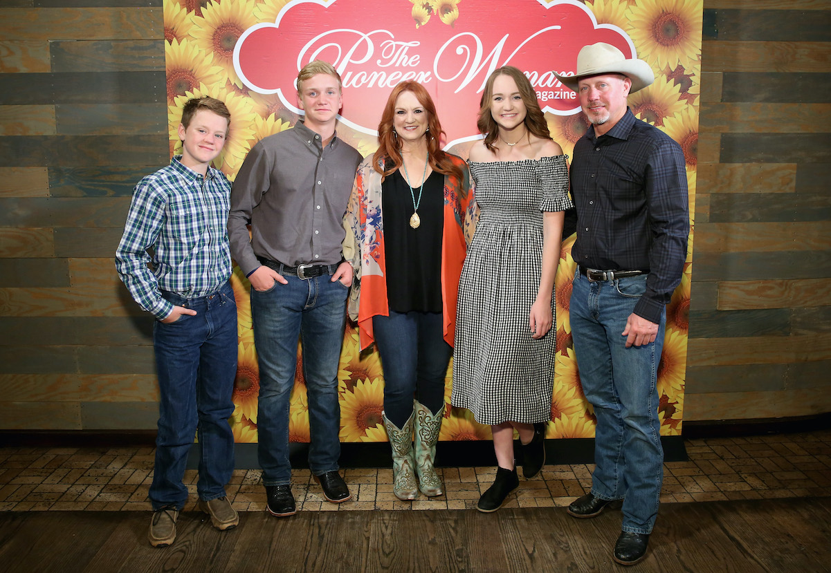 Ree and Ladd Drummond posing with Bryce, Todd, and Paige Drummond at The Pioneer Woman magazine event