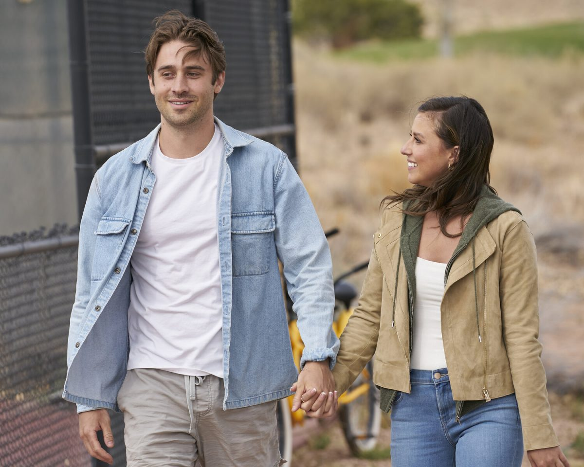 Greg Grippo and Katie Thurston walk holding hands during a date on 'The Bachelorette.'