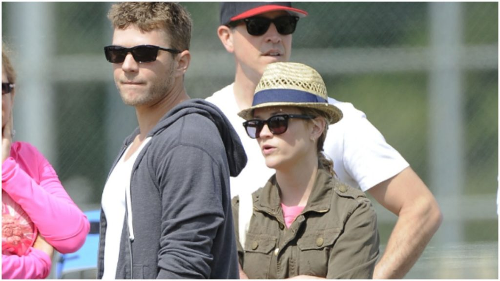 Ryan Phillippe and Reese Witherspoon attend a football game.