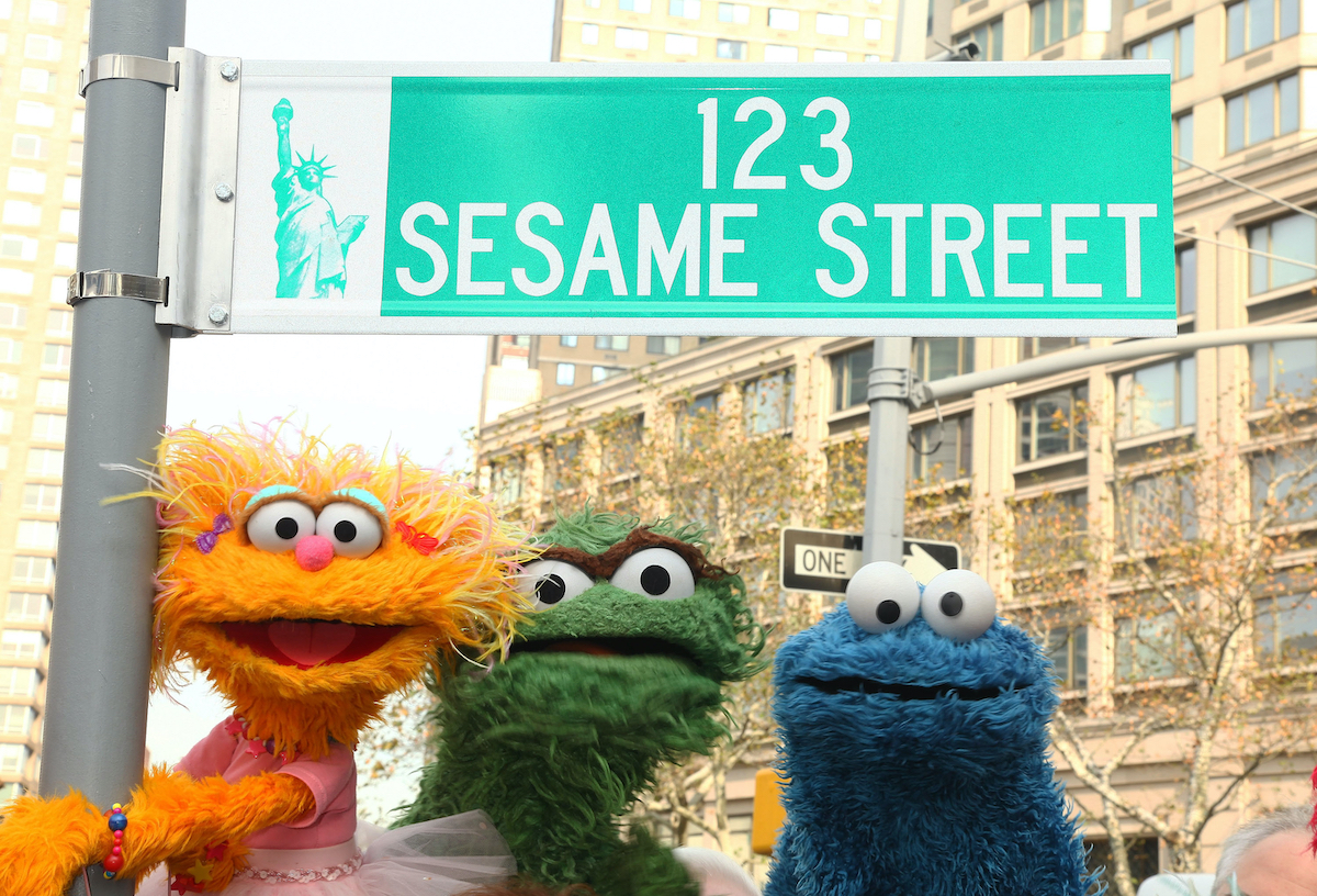 """NEW YORK - NOVEMBER 09: Sesame Street characters pose under a """"123 Sesame Street"""" sign at the """"Sesame Street"""" 40th Anniversary temporary street renaming in Dante Park on November 9, 2009 in New York City. (Photo by Astrid Stawiarz/Getty Images)"""