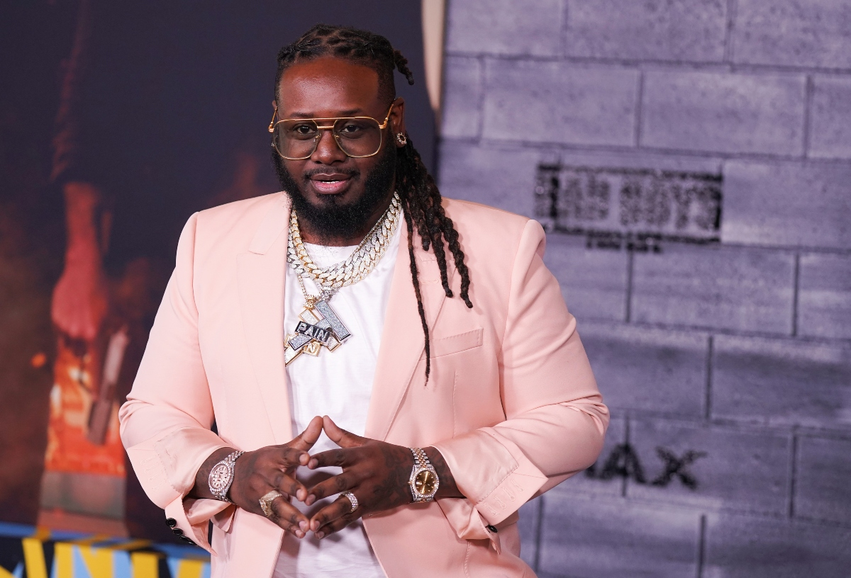 T-Pain wearing a pink suit jacket while heattends premiere of 'Bad Boys for Life' in January 2020 in Hollywood, California
