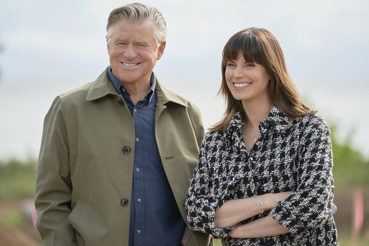 Treat Williams wearing a jacket and Meghan Ory with her arms crossed in 'Chesapeake Shores' Season 5