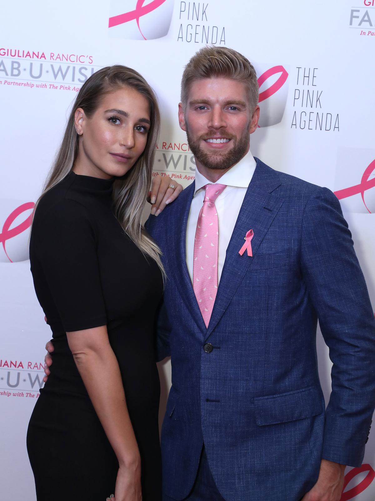 Amanda Batula and Kyle Cooke pose together at an event.