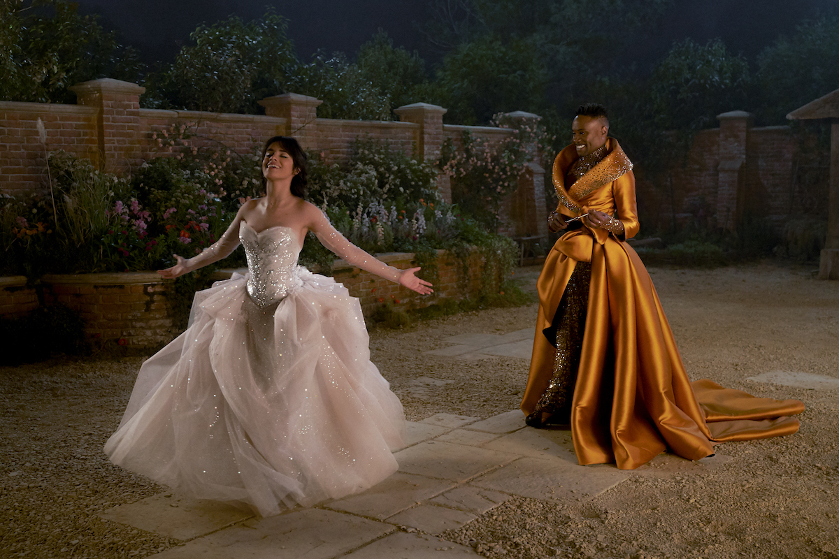 Camila Cabello and Billy Porter in Amazon's 'Cinderella.' Cabello's Cinderella wears a light pink ballgown magically created by Porter's Fab G (aka the Fairy Godmother). The Amazon 'Cinderella' costumes were made by Ellen Mirojnick, who also designed the costumes for Disney's 1997 'Cinderella' starring Brandy.