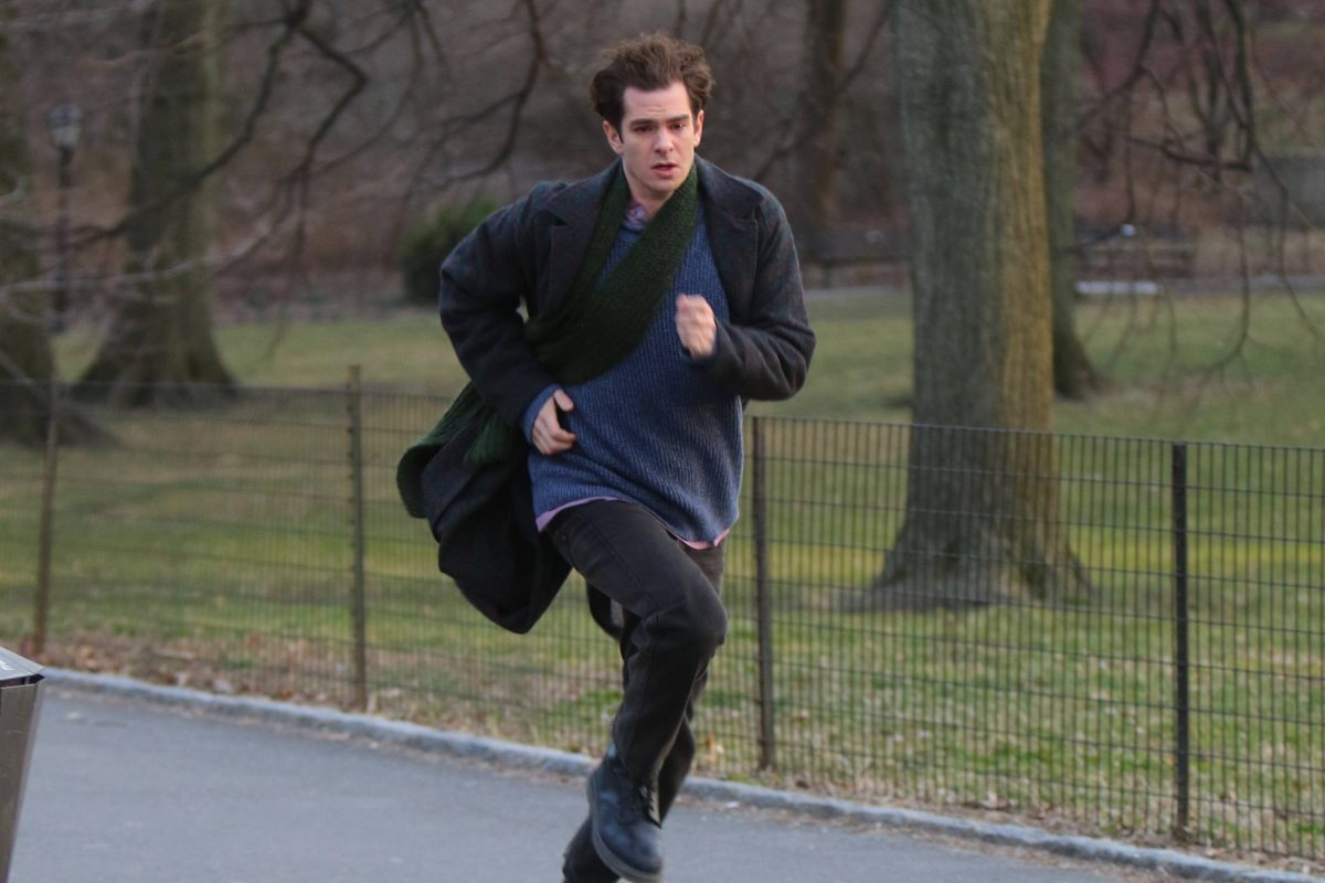 Andrew Garfield running in a black jacket and scarf with a blue t-shirt, while shooting for his movie 'Tick Tick... Boom!' in 2020.