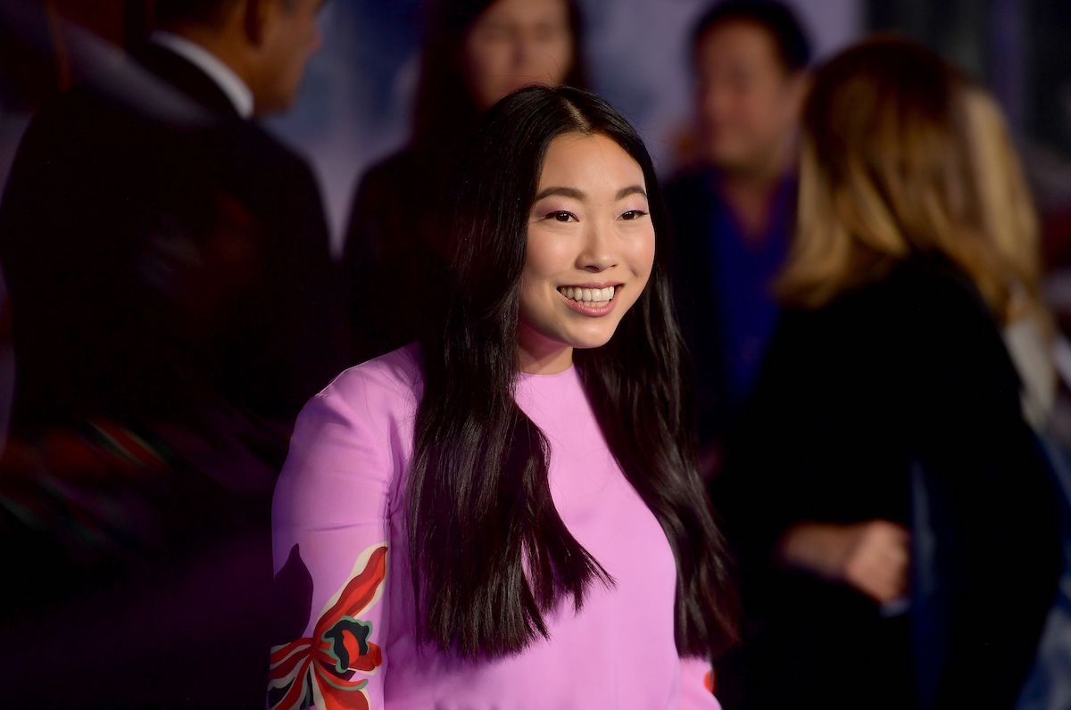 Awkwafina smiles in a pink dress as she poses for cameras at the 2019 premiere of 'Jumanji: The Next Level'