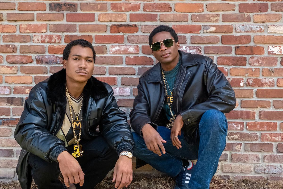 "Demetrius ""Lil Meech"" Flenory Jr. as Demetrius ""Big Meech"" Flenory, and Da'Vinchi as Terry Flenory kneel in front of a brick wall'BMF'"