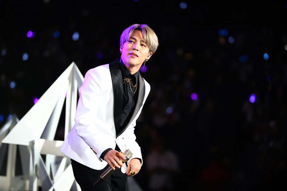 Jimin of BTS wears a white suit onstage at 102.7 KIIS FM's Jingle Ball 2019