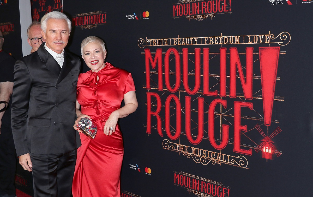 Baz Luhrmann and Catherine Martin smile for the camera.