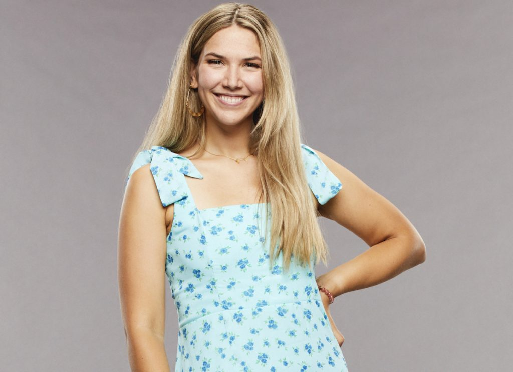 Claire Rehfuss on 'Big Brother' poses in a blue dress.