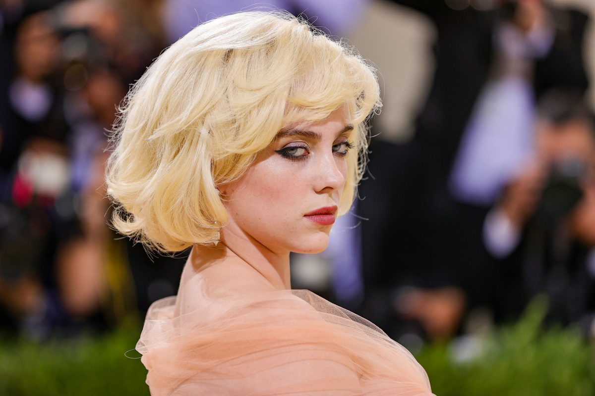A close-up of Billie Eilish attending The 2021 Met Gala Celebrating In America: A Lexicon Of Fashion at Metropolitan Museum of Art on September 13, 2021 in New York City.