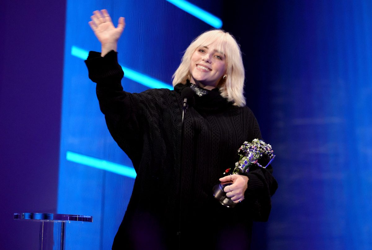 Billie Eilish accepts the Video for Good award for 'Your Power' onstage during the 2021 MTV Video Music Awards at Barclays Center on September 12, 2021 in the Brooklyn borough of New York City. She waves and smiles into the audience.
