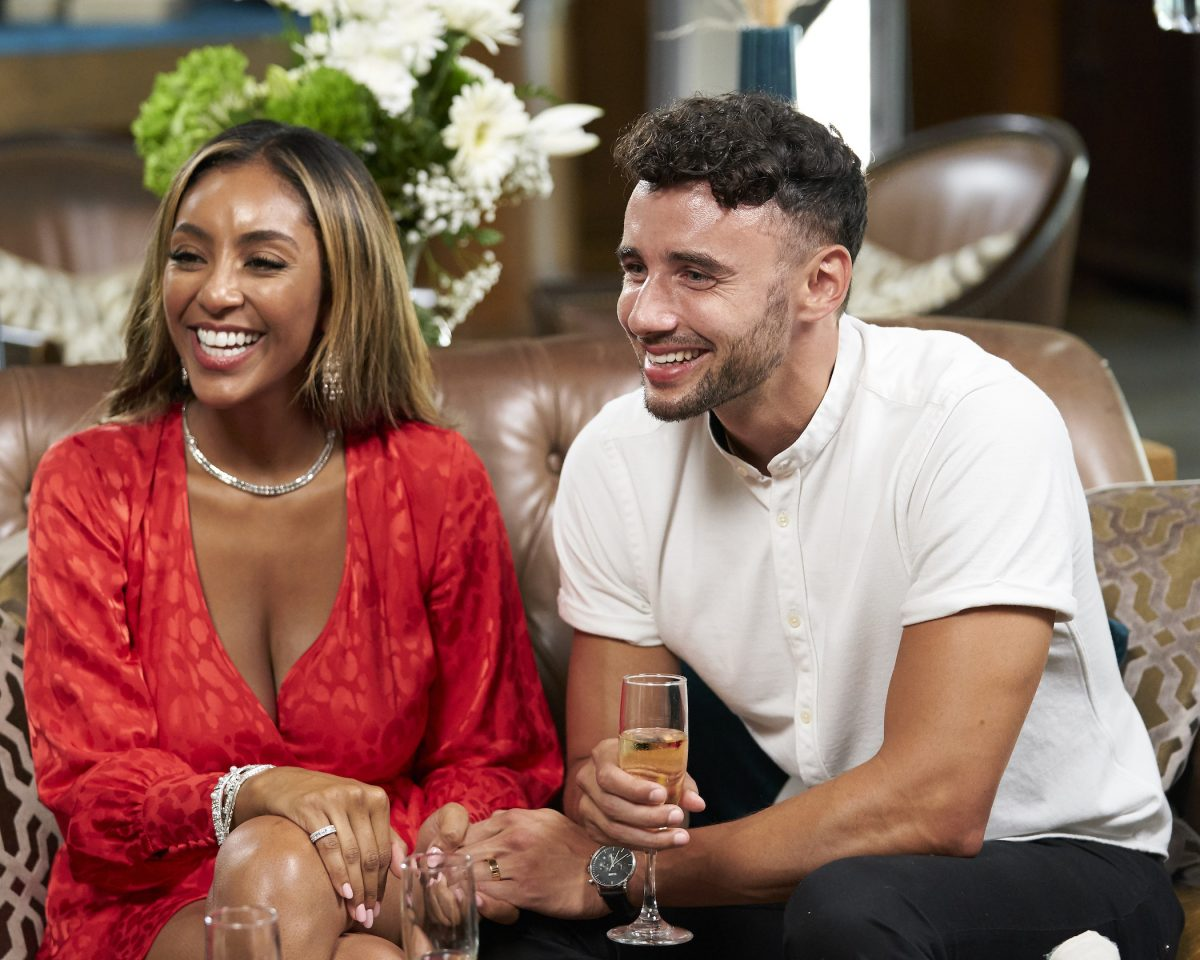 Tayshia Adams and Brendan Morais sitting next to each other and smiling on 'The Bachelorette.' Brendan Morais is on 'Bachelor in Paradise' Season 7