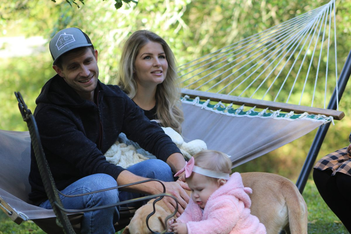 Couple sitting on hammock with baby in scene from 'Bringing Up Bates' Season 10