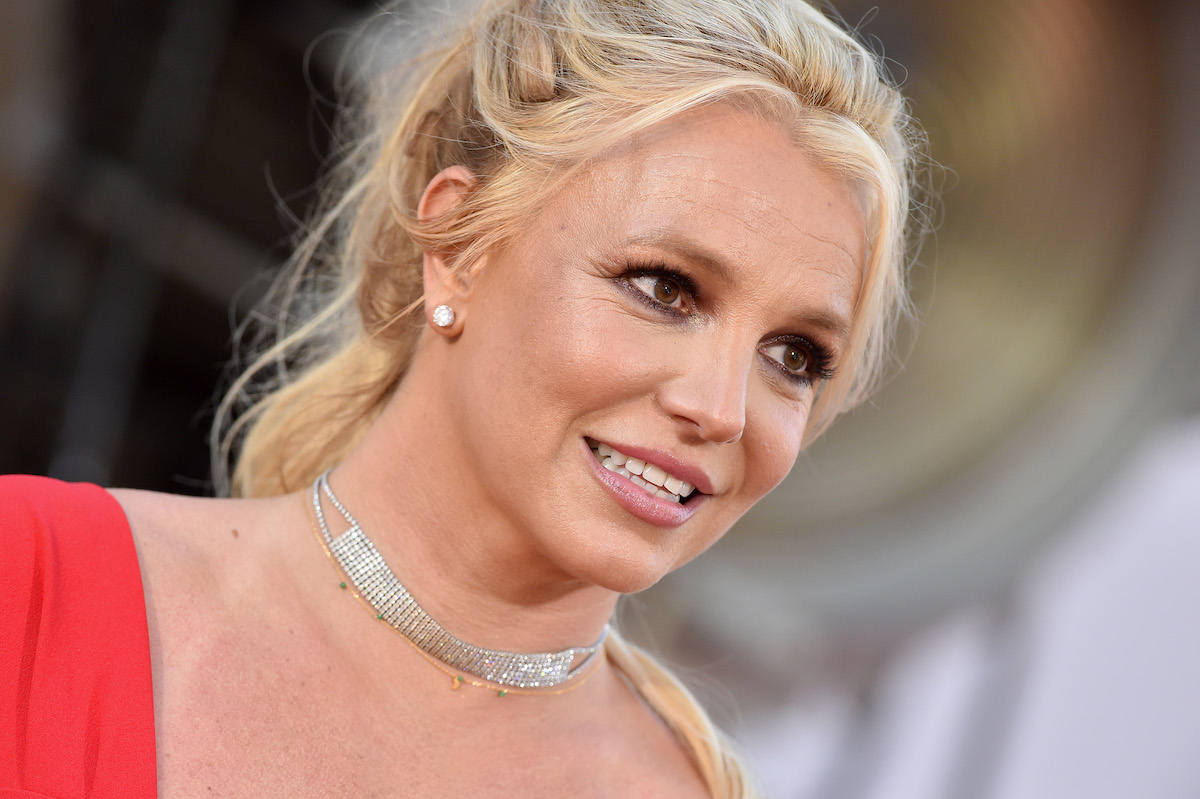 """Britney Spears wears a red gown and diamond earrings as she attends Sony Pictures' """"Once Upon a Time ... in Hollywood"""" Los Angeles premiere in 2019"""