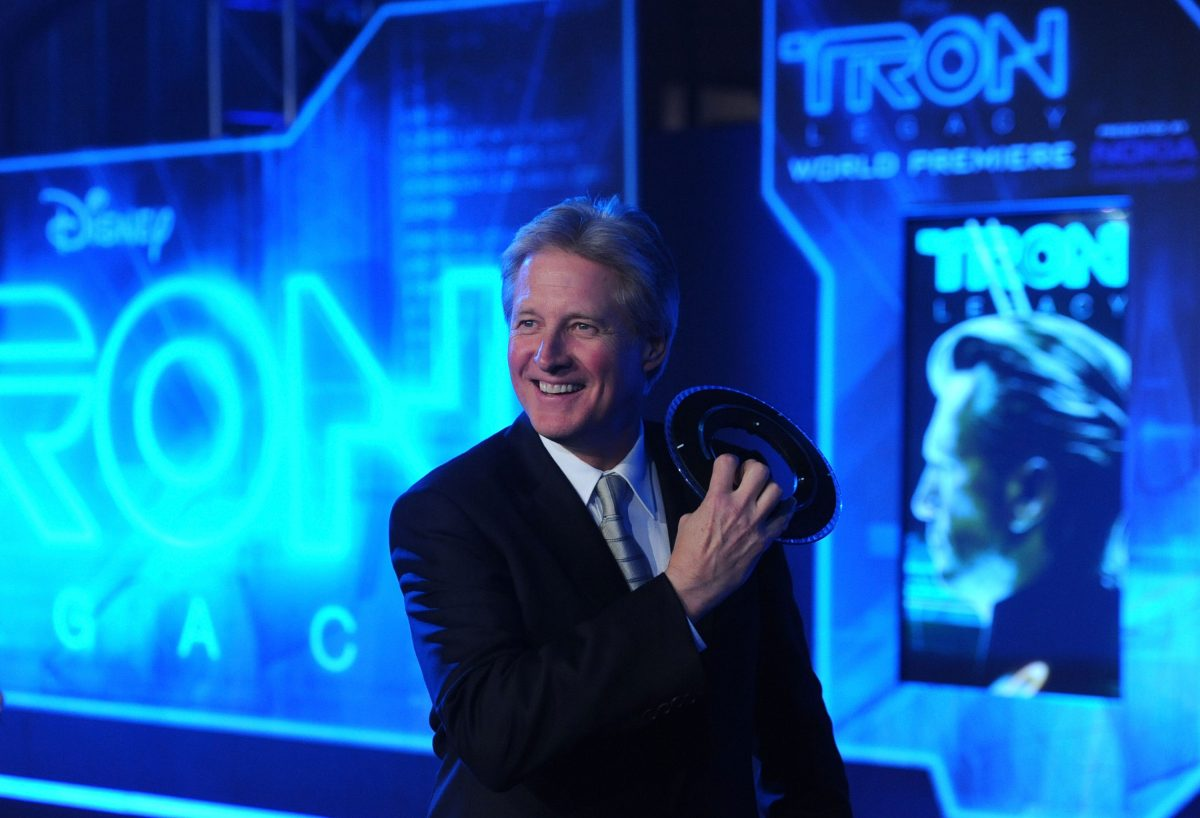 Bruce Boxleitner smiling in a black suit while attending the 'Tron' premiere.