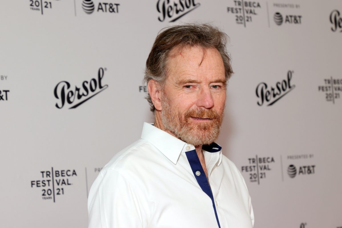 Bryan Cranston smiling in front of a white background