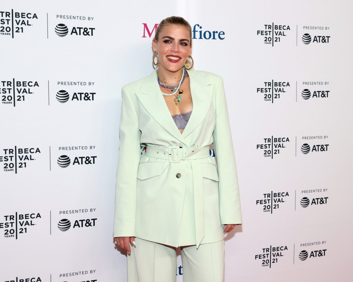 Busy Philipps wears a cream colored suit.