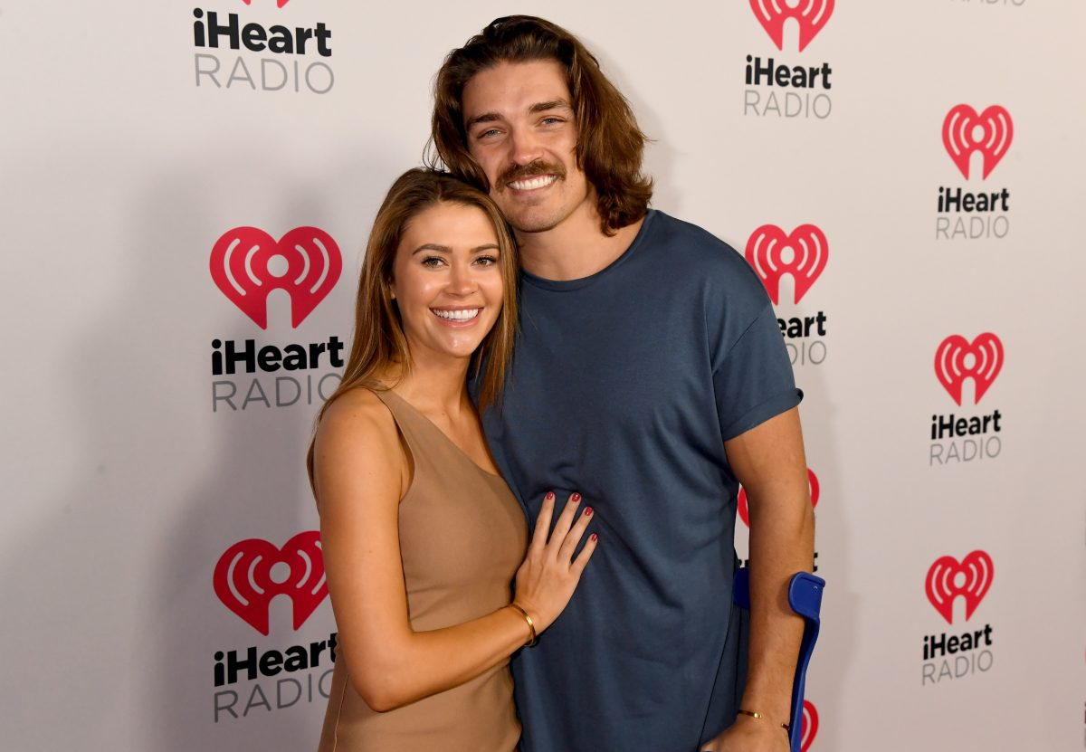 Caelynn Miller-Keyes and Dean Unglert pose together at an iHeart Radio event.