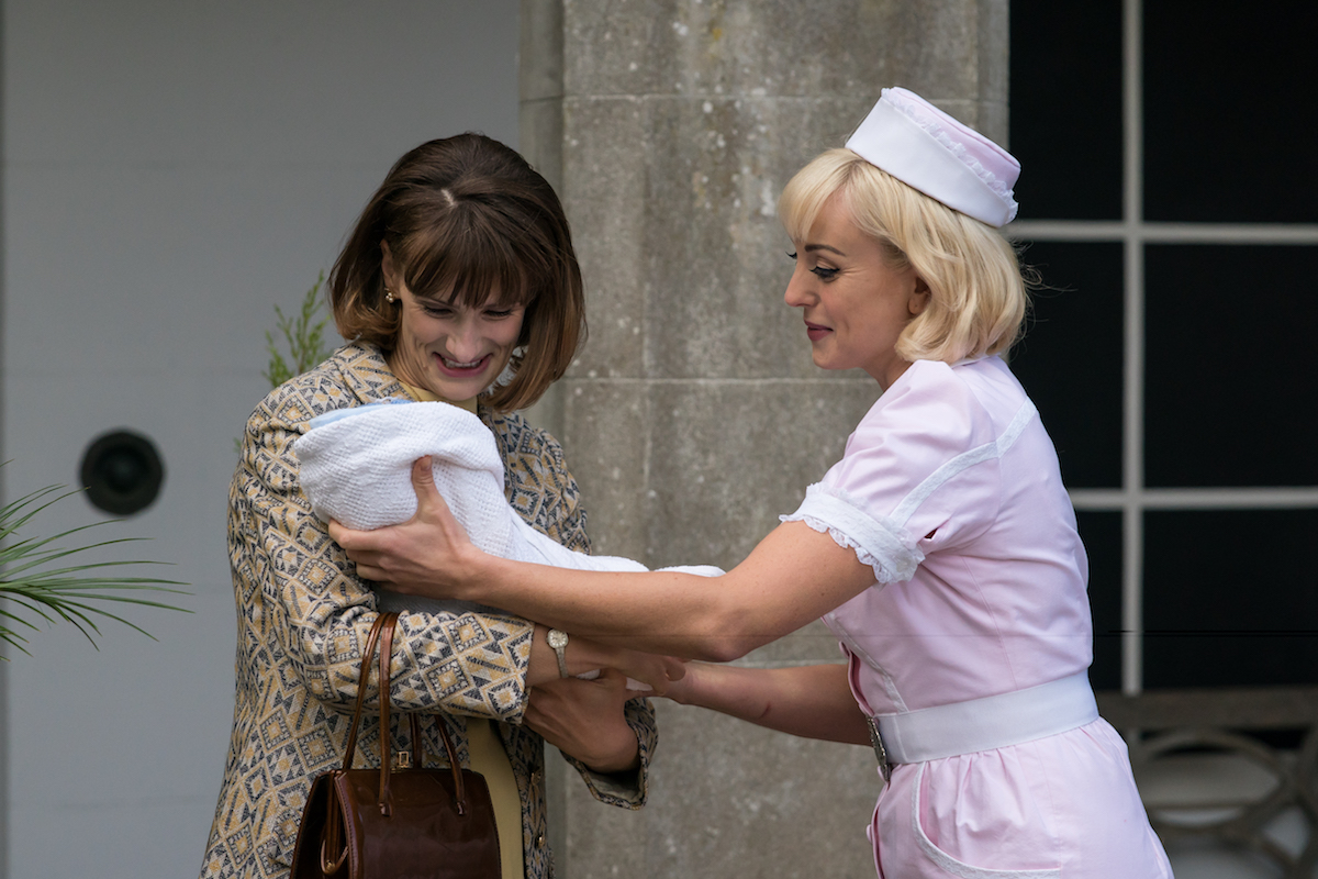 Trixie reaching for a baby in an episode of 'Call the Midwife' Season 10