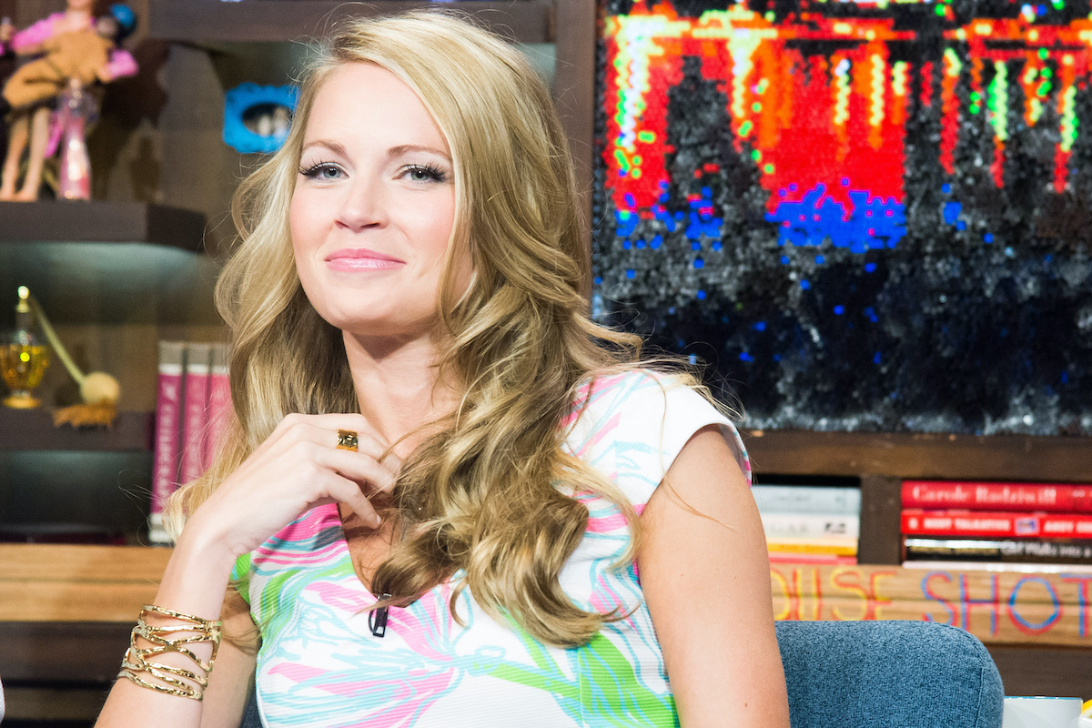 Cameran Eubanks from 'Southern Charm' and 'The Real World: San Diego' wearing a multicolored shirt and sitting in a chair on 'Watch What Happens Live.'