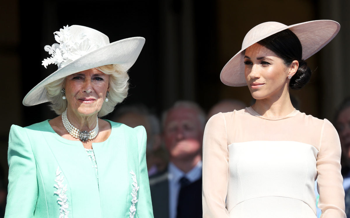 Camilla Parker Bowles and Meghan Markle attend The Prince of Wales' 70th Birthday Patronage Celebration held at Buckingham Palace on May 22, 2018 in London, England