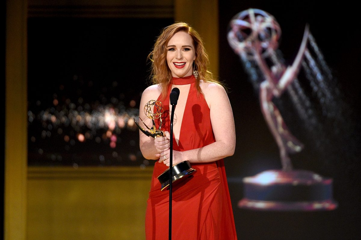 'The Young and the Restless' actor Camryn Grimes in a red dress as she accepts the Supporting Actress award at the 2018 Daytime Emmy Awards.