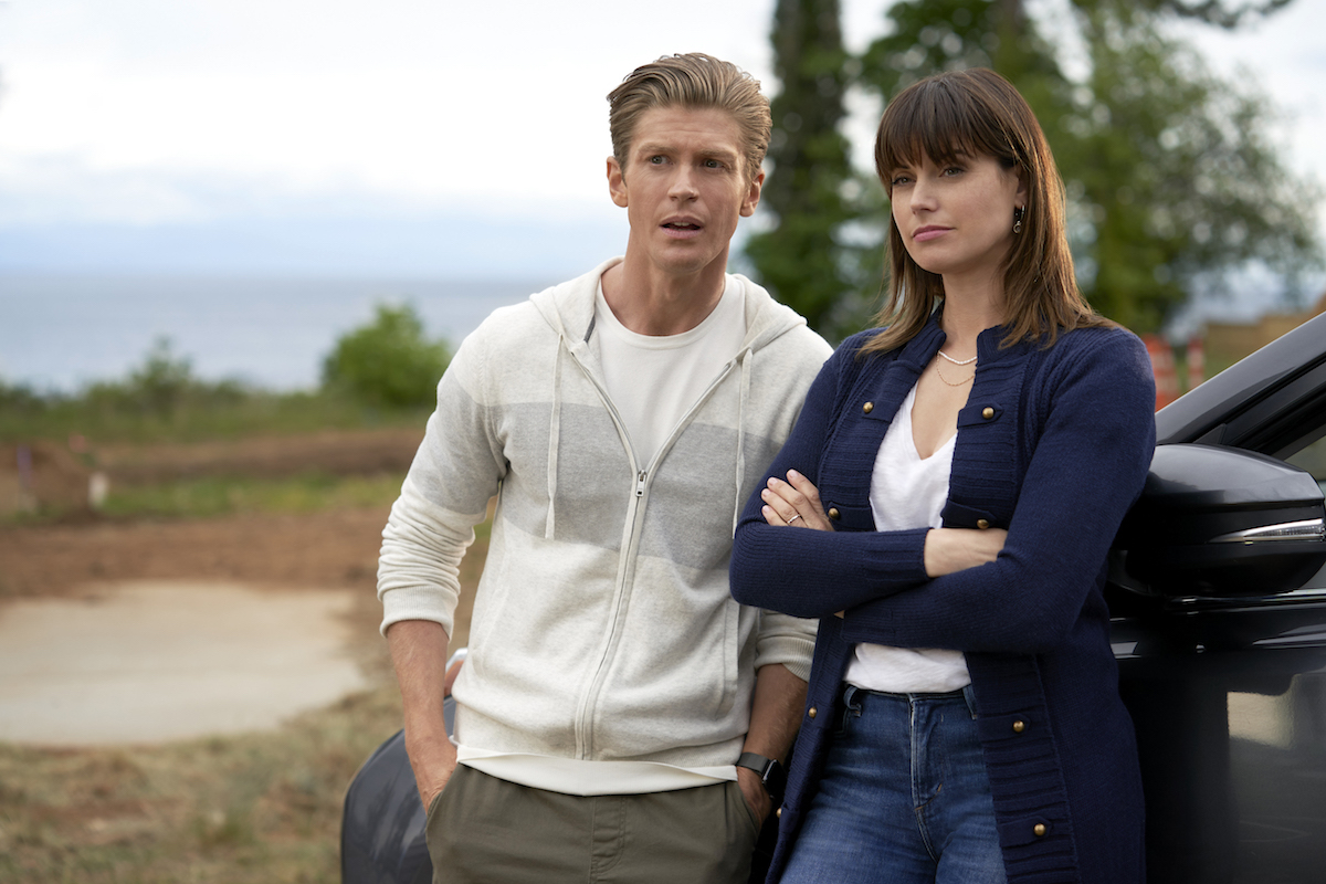 Meghan Ory with her arms crossed standing next to Andrew Francis in 'Chesapeake Shores' Season 5