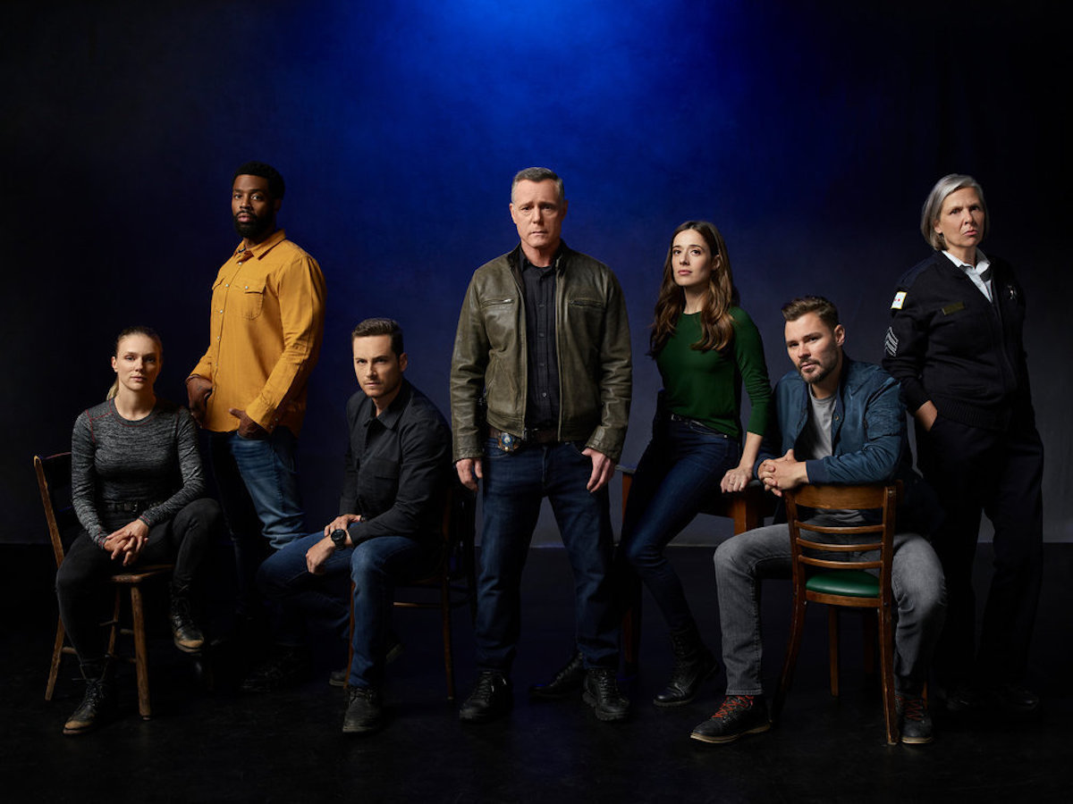The 'Chicago P.D.' Season 9 cast looking serious against a dark blue background