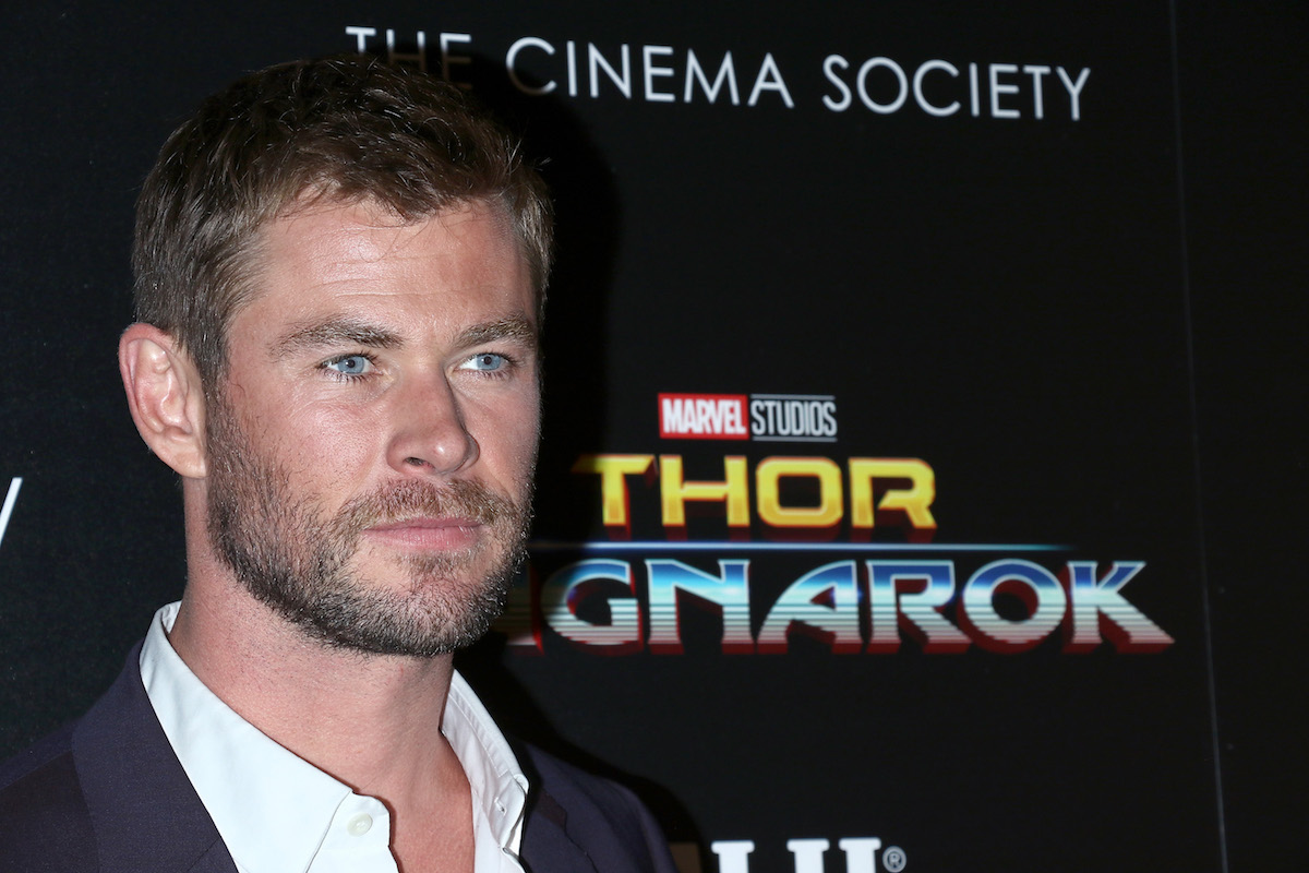 Chris Hemsworth in front of a 'Thor' banner