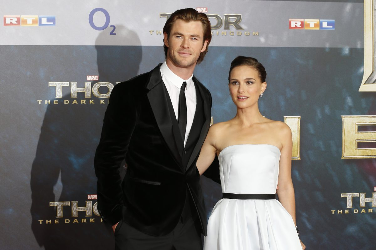 Cast members of Thor 4 Love and Thunder Chris Hemsworth and Natalie Portman smiling for cameras at a Thor premiere