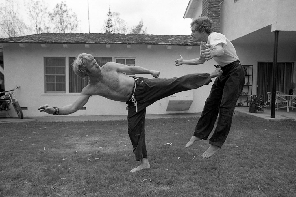 Chuck Norris practicing martial arts with his trainer in Los Angeles, California