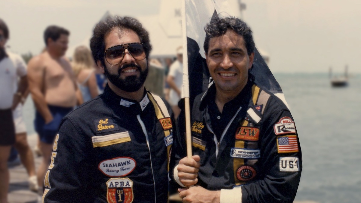 Salvator Magluta and Augusto 'Willie' Falcon smile and hold a flag in 'Cocaine Cowboys: The Kings of Miami