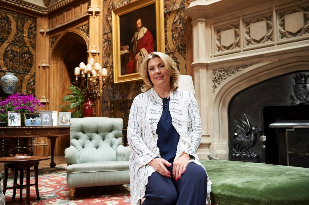 Countess Carnarvon sitting in the living room at Highclere Castle.