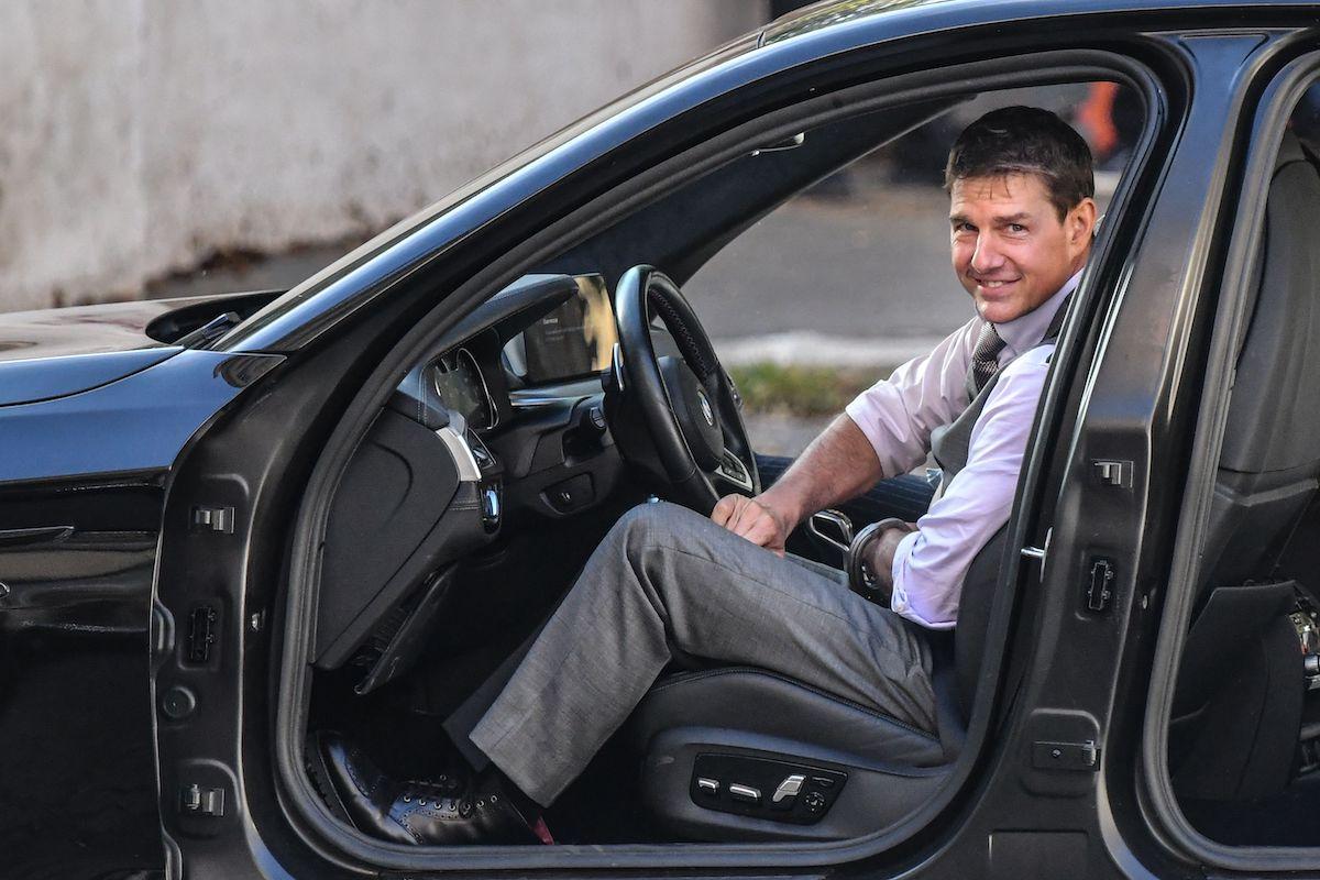 Tom Cruise sitting in a stunt car