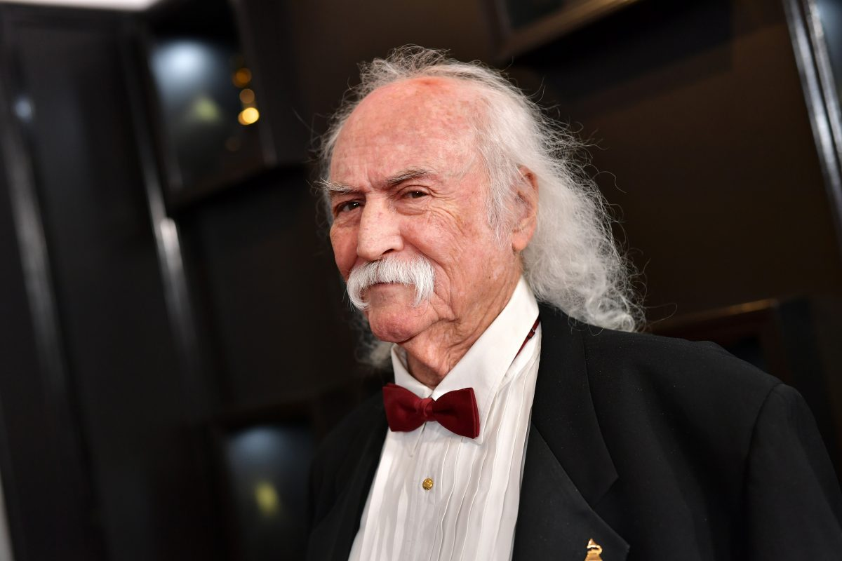 David Crosby in a black tuxedo with a red bow tie.