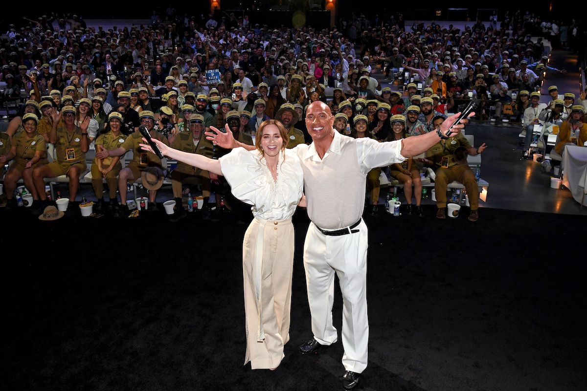 Emily Blunt and Dwayne Johnson raise their arms