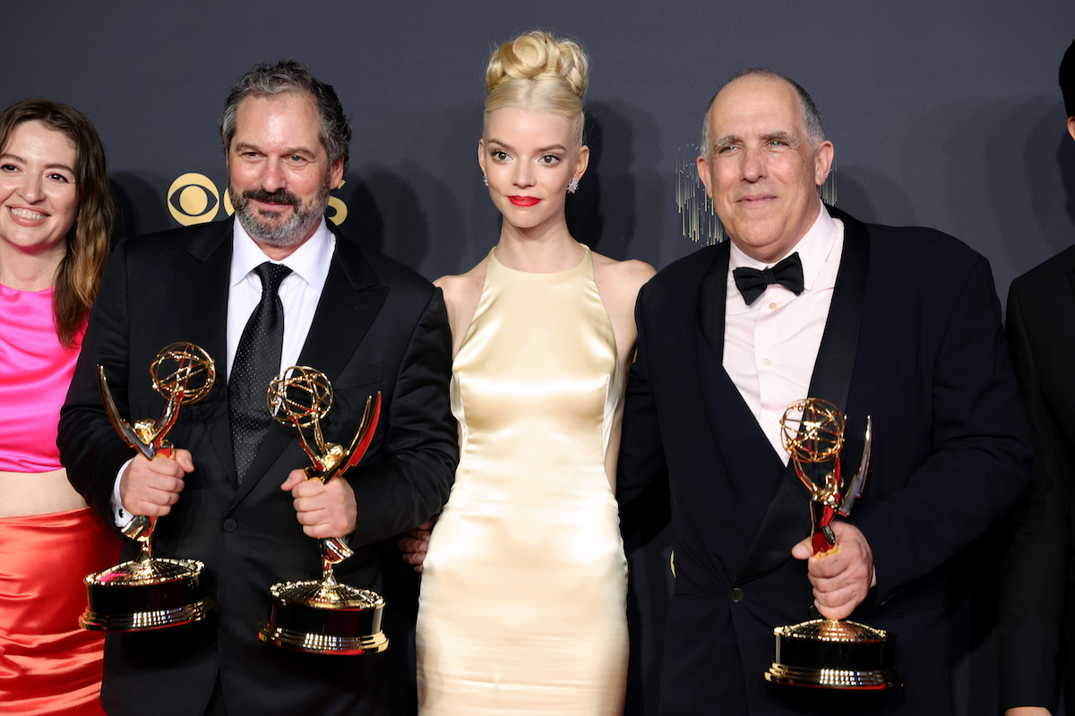 Anya Taylor-Joy posing with Marielle Heller, Scott Frank, and William Horberg at the 73rd annual Emmy Awards.