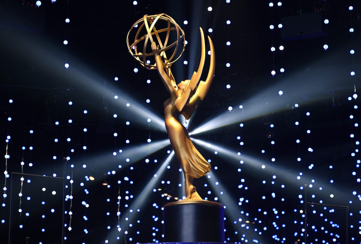 Large model of the statuette of the Emmy Award illuminated on a stage