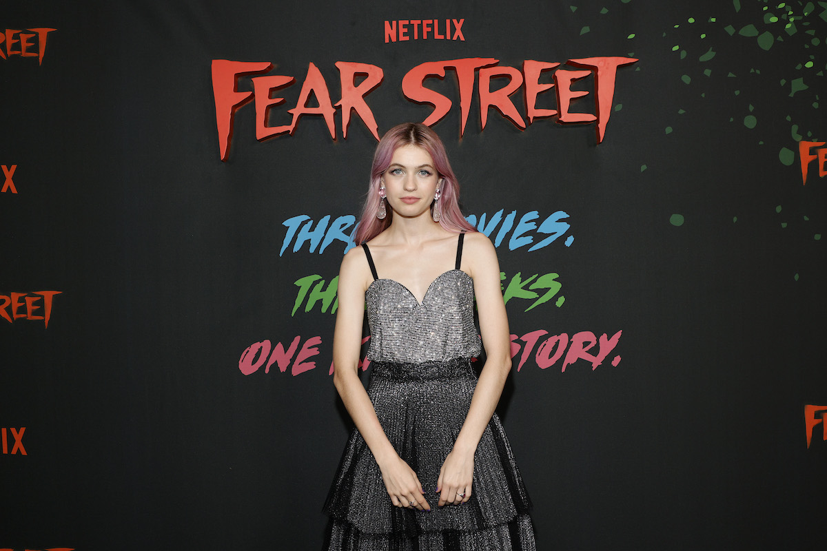 Olivia Scott Welch wearing a silver and black dress at a 'Fear Street' event.